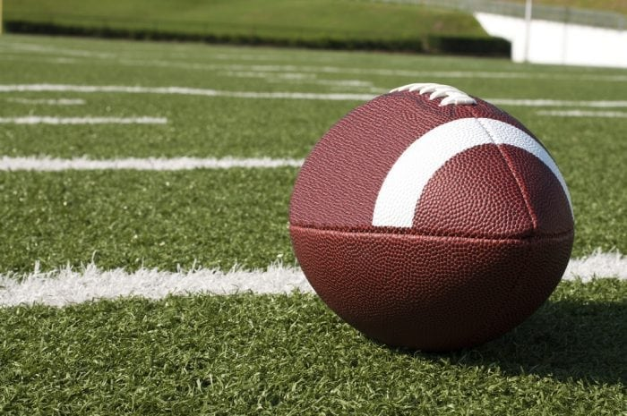 """""""A football on a field"""" (https://www.flickr.com/photos/usdagov/21848251428) by the US Department of Agriculture (via Flickr) is licensed under CC BY 2.0 (https://creativecommons.org/licenses/by/2.0/)"""