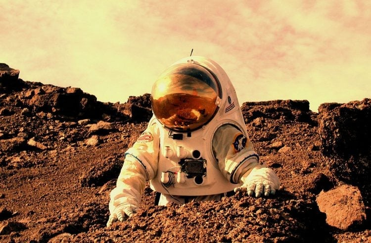 """""""Rendition of person in a spacesuit on Mars"""" by NASA via Wikimedia Commons is licensed under CC0"""