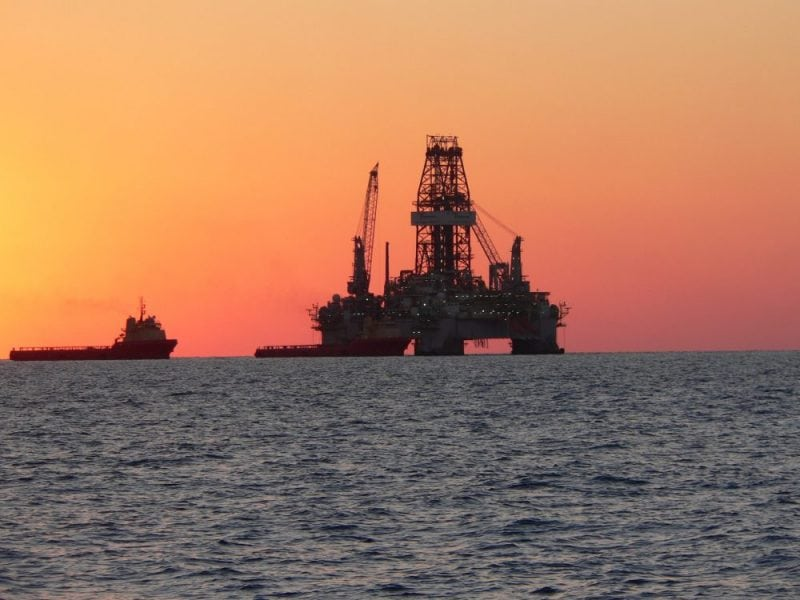 Drill rig with supply ships at dusk (credit: Alan M. Shiller)