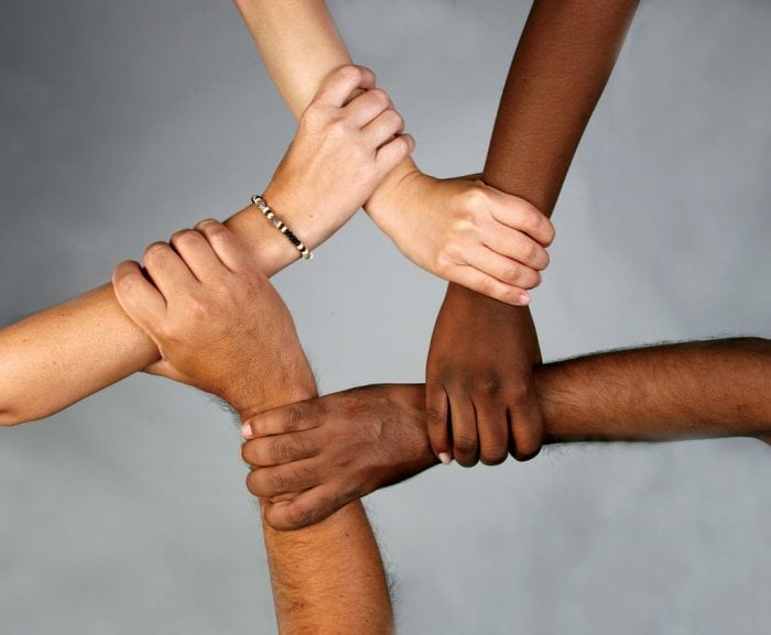"""""""School diversity many hands held together"""" by Wonder woman0731 (via Flickr) is licensed under CC BY 2.0"""