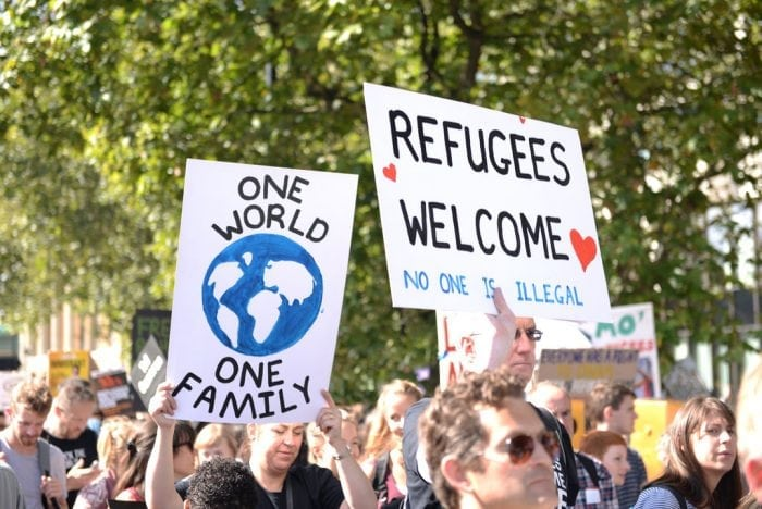 """One world - Refugees Welcome"" by Ilias Bartolini (via Flickr) is licensed under CC BY-SA 2.0"
