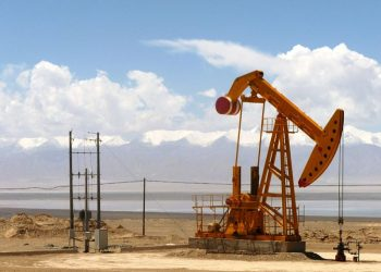 """""""Oil well in Tsaidam"""" by John Hill (via Wikimedia Commons) is licensed under the Creative Commons Attribution-Share Alike 3.0 Unported license."""