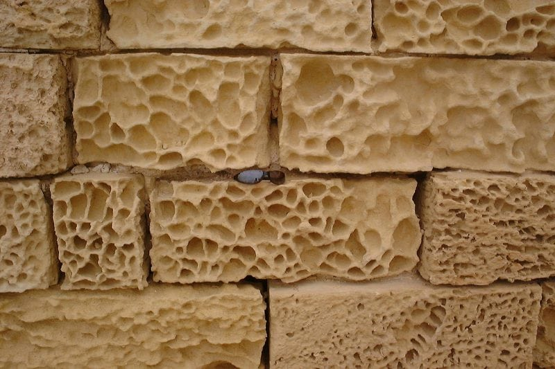 Building stones on the island of Gozo, Malta have become chemically weathered by salt. Credit: Wikipedia