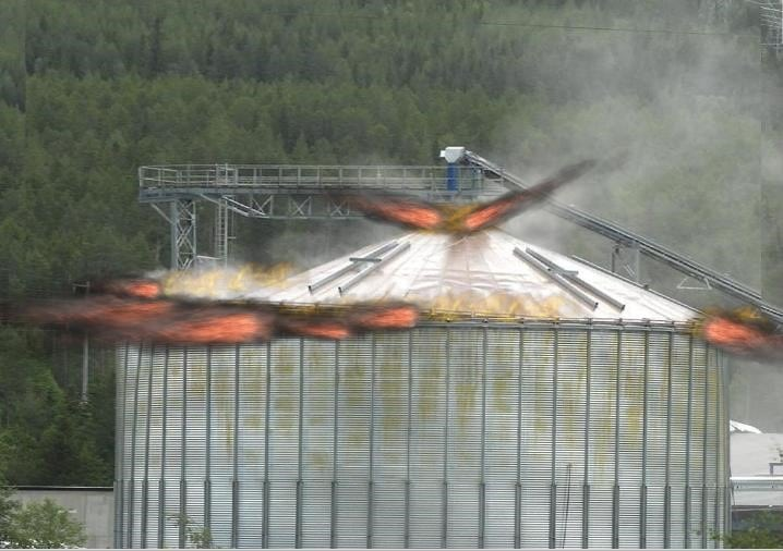 The force of the 2010 silo explosion lifted the 27 ton roof upwards and enveloped the firefighters in flames. The Norwegian investigation report stated dryly, that if anything positive should be said about this incident, it must be that the firefighters' personal protective equipment performed excellently. Photo courtesy: Dag Botnen, Hallingdal brann- og redningstjeneste, Norway