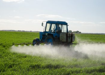 """""""Tractor Fertilize Field Pesticide And Insecticide"""" by Aqua Mechanical via Flickr is licensed under CC BY 2.0"""