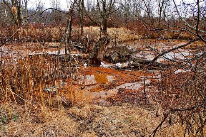 """Ohio Valley Mushroom Farm, Acid-Mine Drainage (AMD)"" by Jack Pearce via Wikimedia Commons is licensed under the Creative Commons Attribution-Share Alike 2.0 Generic license."