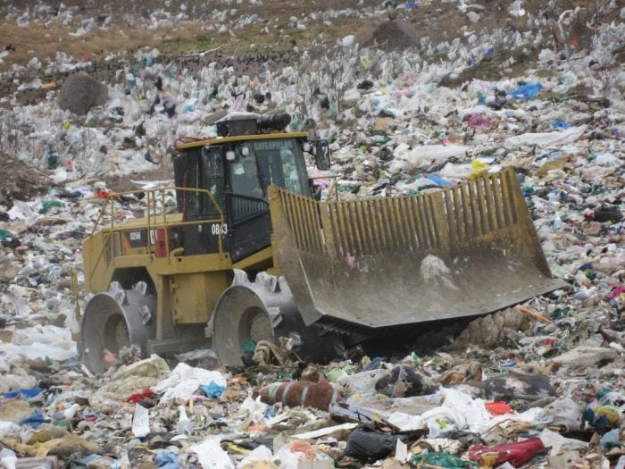 """""""Heavy machinery at the Robin Hood Bay landfill"""" by Colin Delaney via Flickr is licensed under CC BY 2.0"""