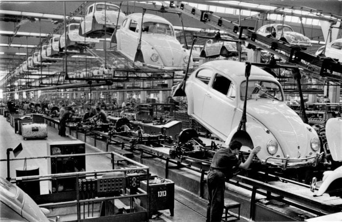 """Volkswagen Beetle Assembly Line"" by Alden Jewell via Flickr is licensed under CC BY 2.0"