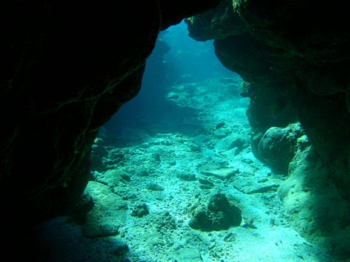 """Underwater Cave, Fiji"" by Erin Khoo (via Flickr) is licensed under CC BY 2.0"