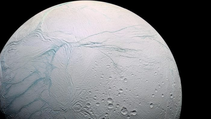 """Saturn's moon Enceladus-hires"" by Marc Van Norden (via Flickr) is licensed under CC BY 2.0"