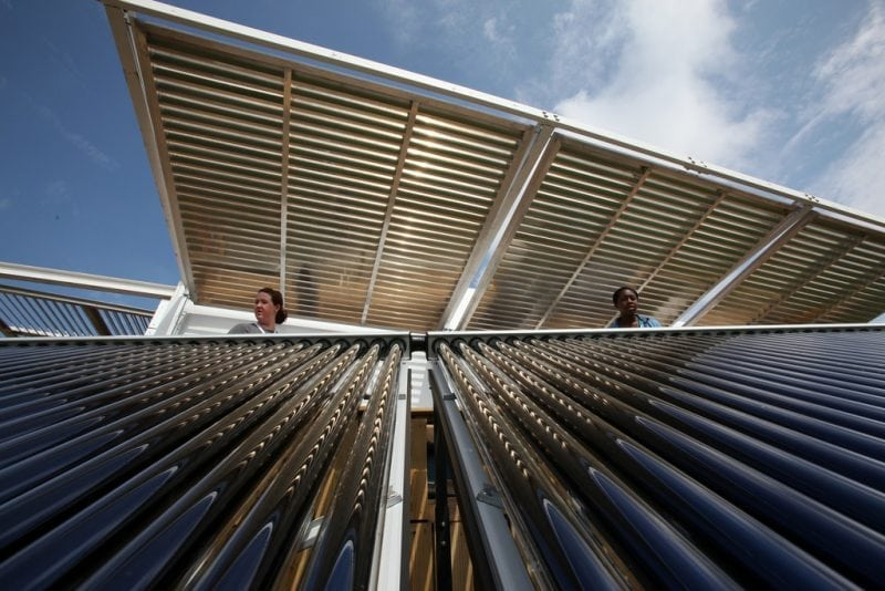 """FIU Solar Thermal Collector System"" by Stefano Paltera/U.S. Department of Energy Solar Decathlon (via Flickr) is licensed under CC BY-ND 2.0"