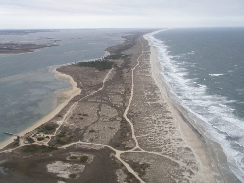 In the Outer Banks, NC, underlying geology plays a role in barrier behavior but is masked by covering sand (Credit: )
