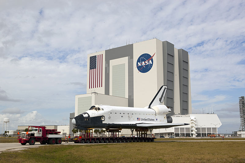 """""""Space Shuttle Explorer moves past VAB at Kennedy Space Center"""" by NASA/Dimitri Gerondidakis via Wikimedia Commons is licensed under CC0"""
