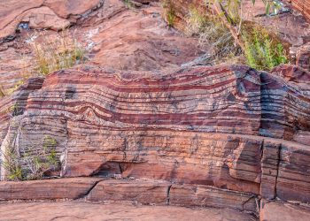 """Banded iron formation, Karijini National Park, Western Australia"" by Graeme Churchard from Bristol, UK - Dales Gorge Uploaded by PDTillman via Wikipedia. Image licensed under CC-BY 2.0 https://creativecommons.org/licenses/by/2.0"